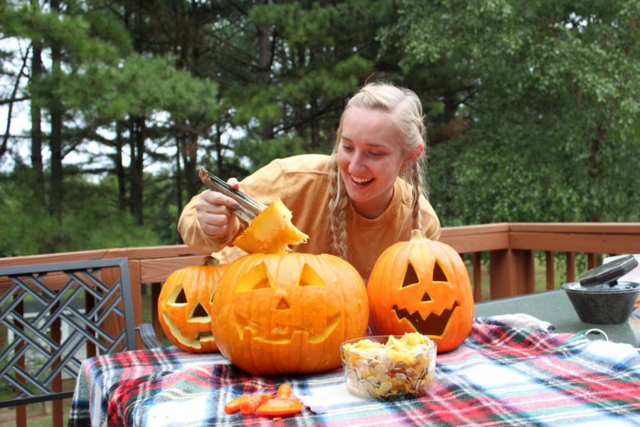 Senior Haley Rosson carves a few pumpkins to help advertise this year's division-wide contest.