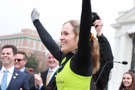 Kate Fletcher runs up the steps to the Capitol, completing her over 50-mile journey.