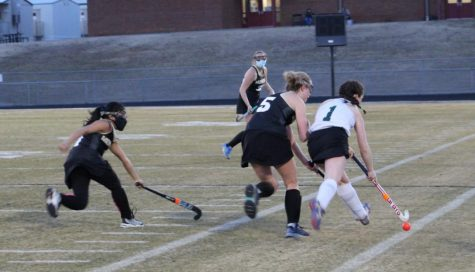 Junior Ali Downey speed dribbles down the sideline.