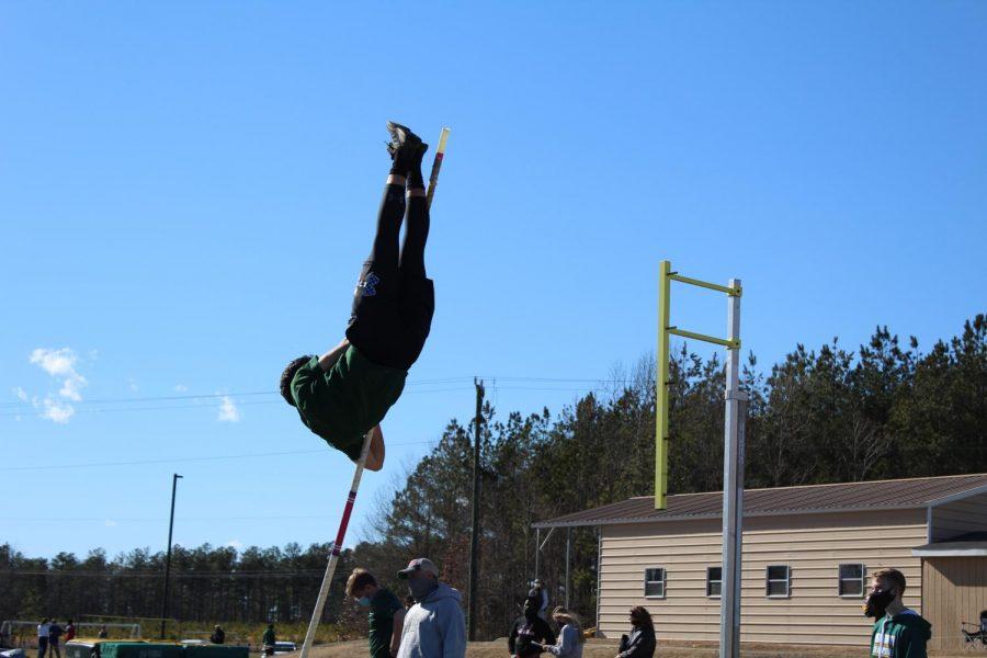 Junior Lucas Cash competing in Pole Vault during regionals.