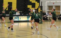 The Lady Lions come together to celebrate a kill.