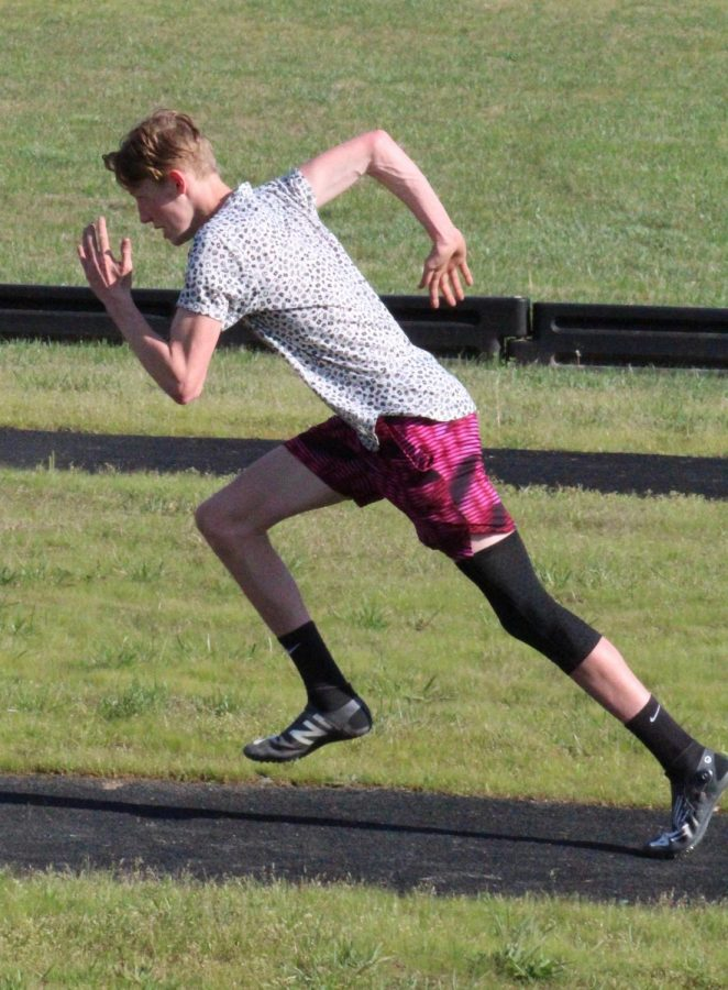 Sophomore Wyatt Snyder sprints his way down the track.