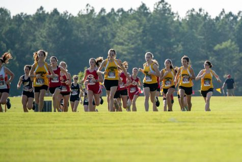 Girls cross country runners run in a Goochland meet.